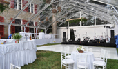 50� wide clear top frame tent with white dance floor, custom railing package and white chiavari chairs