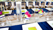 White square china, water goblets and gold chiavari chairs